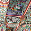 Detail of decorative painting on beams at the old Buddhist temple in central Seoul, South Korea.