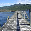 The famously long and shaky Tokaanu Wharf which juts out into beautiful Lake Taupo in New Zealand's North Island. Tiny Tokaanu boasts a fascinating Maori and settler history, cheap property, hot pools and is within a short drive of the ski-fields.