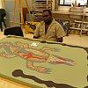 Aboriginal artist at work in remote Wajul Wajul on York Peninsula, Queensland's far north