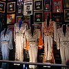 Elvis has left the building but his ghostly presence remains. Some of the King's stage clothes at Graceland in Memphis, Tennessee.