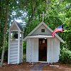 The smallest church in America so they say. This one is in Georgia. There is another smallest church on north central California, and doubtless a few others elsewhere. This holds maybe six people. Tops.