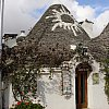 Trulli house with esoteric roof painting, Alberobello, Italy